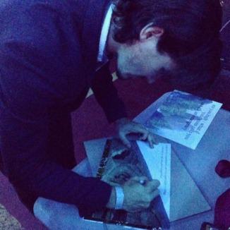Chris signs his tweets